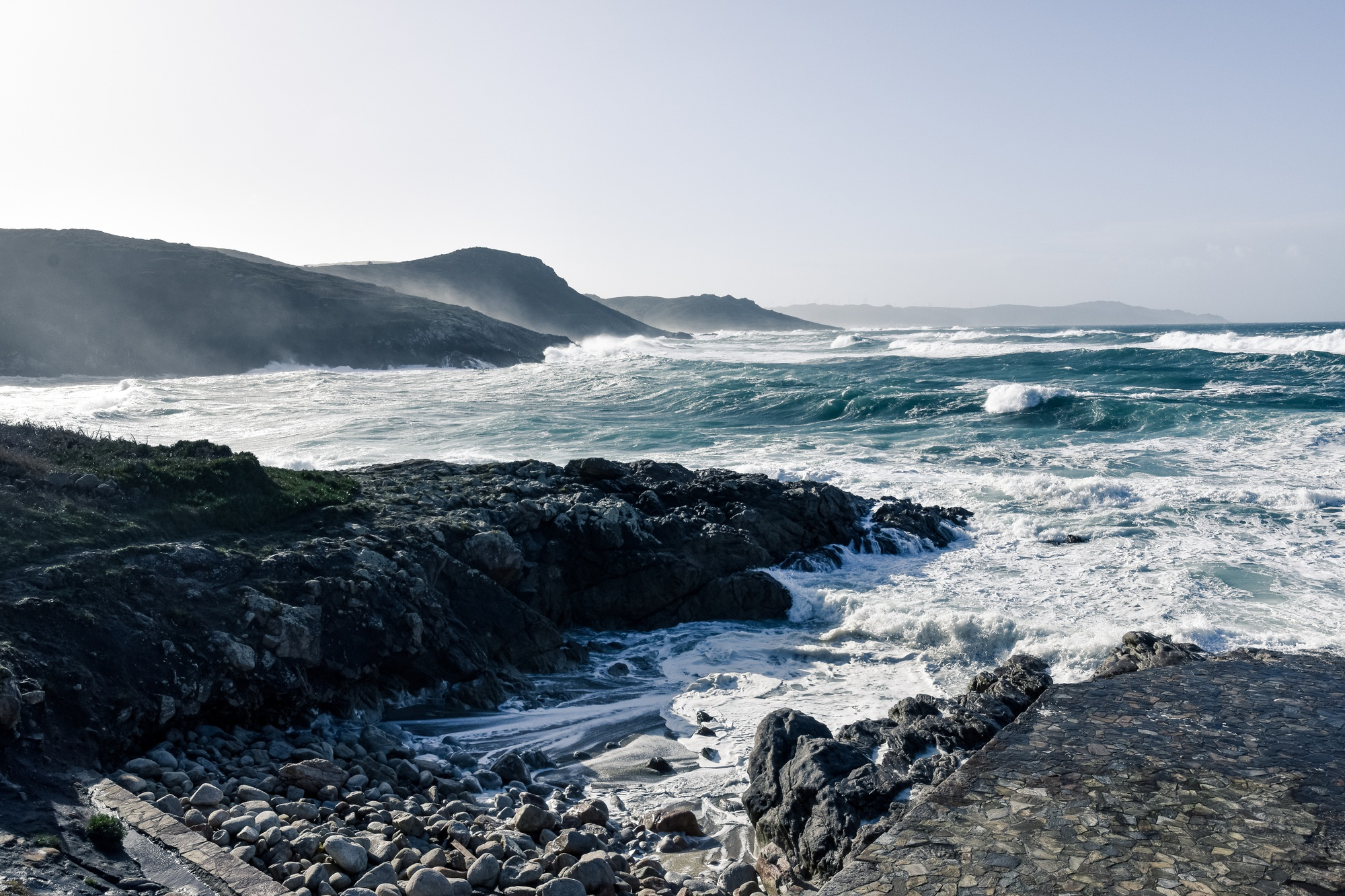 magnificent-ocean-waves-coming-beautiful-rocks-beach-cloudy-day (1)